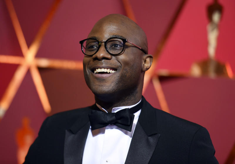 """FILE - In this Feb. 26, 2017 file photo, director Barry Jenkins arrives at the Oscars in Los Angeles. Jenkins has unveiled the teaser trailer for his anticipated """"Moonlight"""" follow-up, """"If Beale Street Could Talk,"""" based on the 1974 novel by James Baldwin. (Photo by Richard Shotwell/Invision/AP, File)"""