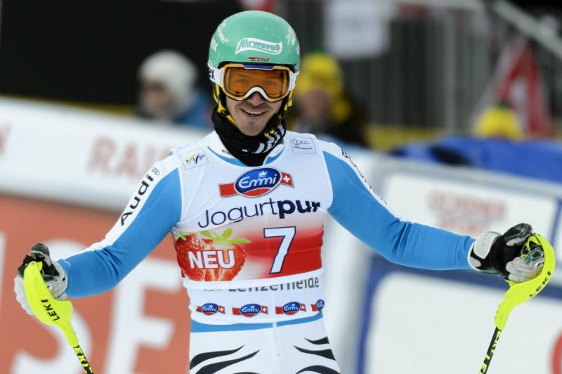 Felix Neureuther of Germany reacts in the finish area during the first run of the men's World Cup Slalom at the FIS Alpine Ski World Cup finals, in Parpan, Lenzerheide, Switzerland, Sunday, March 17, 2013. (AP Photo/Keystone/Laurent Gillieron)
