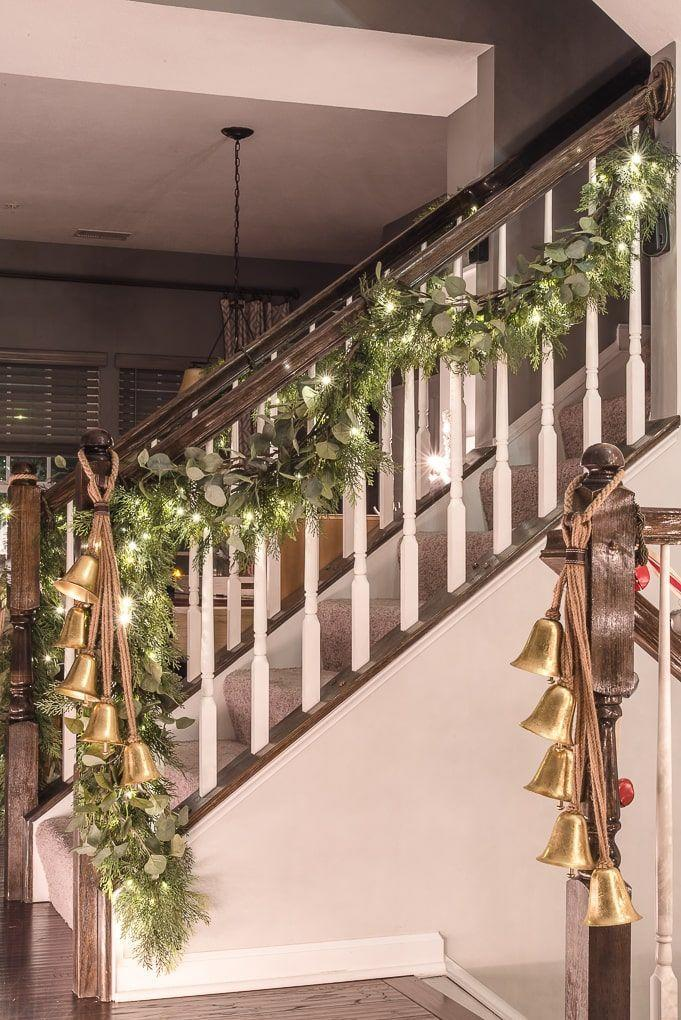 """<p>A grouping of bells that looks like they're pulled straight from Santa's sleigh is an easy way to elevate a simple lit garland. </p><p><em>See more at <a href=""""https://www.keystoinspiration.com/merry-bright-christmas-lights-home-tour/"""" rel=""""nofollow noopener"""" target=""""_blank"""" data-ylk=""""slk:Keys to Inspiration"""" class=""""link rapid-noclick-resp"""">Keys to Inspiration</a>. </em></p><p><a class=""""link rapid-noclick-resp"""" href=""""https://www.amazon.com/Melrose-Decorative-Hanging-Bells-Ornament/dp/B07DC6FYR6?tag=syn-yahoo-20&ascsubtag=%5Bartid%7C10072.g.34479907%5Bsrc%7Cyahoo-us"""" rel=""""nofollow noopener"""" target=""""_blank"""" data-ylk=""""slk:SHOP HANGING BELLS"""">SHOP HANGING BELLS</a></p>"""
