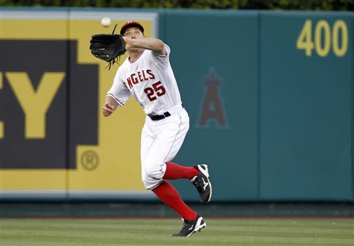 Los Angeles Angels center fielder Peter Bourjos (25) catches a fly ball hit by Detroit Tigers' Austin Jackson in the first inning during a baseball game Friday, April 19, 2013, in Anaheim. (AP Photo/Alex Gallardo)