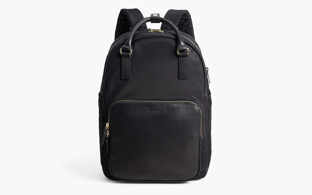 """<p><a href=""""https://www.travelandleisure.com/style/travel-bags/best-laptop-bags"""" target=""""_blank"""">Laptop bags</a> are usually more on the utilitarian side of design but this one is an exception. But don't let its stylish exterior fool you, it's still packed with great features. It has a separate padded and zippered sleeve that fits a 13-inch laptop close to your back for comfort. The backpack straps easily tuck away to convert it into a tote, and you can even attach it to the handles of your suitcase thanks to a pass-through sleeve on its back.</p> <p>To buy: <a href=""""https://www.pntra.com/t/8-12260-131940-189946?sid=TL%2C15ConvertibleBagsThatDoDouble%2528andTriple%2529Duty%2Cdibeneds%2CTRA%2CGAL%2C721726%2C201910%2CI&url=https%3A%2F%2Fwww.loandsons.com%2Fproducts%2Frowledge-nylon-black-gold-grey"""" target=""""_blank"""">loandsons.com</a>, $375</p>"""