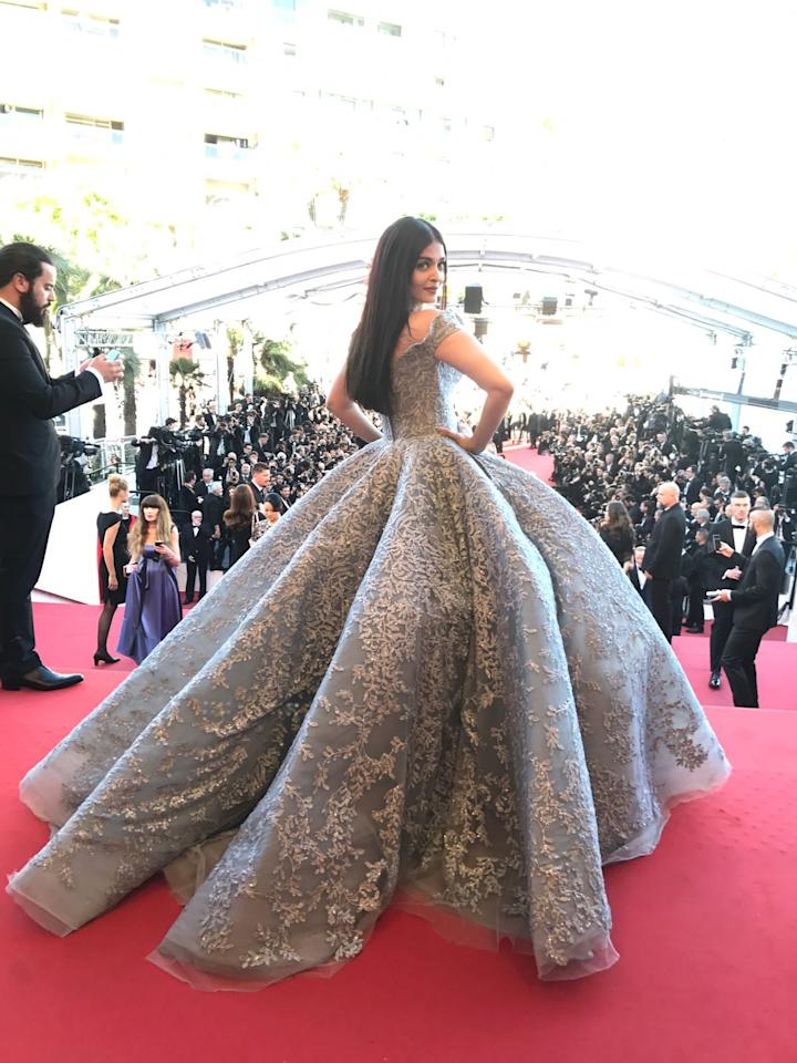 """<p>Recommended Read:<a rel=""""nofollow"""" href=""""https://www.pinkvilla.com/entertainment/photos/378984/cannes-2017-aishwarya-rai-bachchans-red-carpet-look-stunning-see-pics?utm_source=yahoo&utm_medium=referral&utm_content=yahoomovies""""> Cannes 2017: Aishwarya Rai Bachchan's red carpet look is stunning. See pics </a></p><p>Today, Aishwarya is all set to attend the screening of Okja at Palais des Festivals in Cannes, France. The actress had mentioned that she is looking forward to catch all the spectacular movies at the festival.</p><p>This is Aishwarya's third look of the day. She was earlier seen in a <a rel=""""nofollow"""" href=""""https://www.pinkvilla.com/fashion/celebrity-style/378959/cannes-2017-aishwarya-rai-bachchans-first-look-hot-hell"""">green tissue, maxi dress</a> by Yanina Couture and a beautiful Yanina <a rel=""""nofollow"""" href=""""https://www.pinkvilla.com/fashion/celebrity-style/378982/yay-or-nay-aishwarya-rai-bachchan-mark-bumgarner"""">outfit</a>. Which of the three looks do you like the best?</p><p>Aishwarya landed at the French Riviera yesterday with her mom Vrinda Rai and daughter <a rel=""""nofollow"""" href=""""https://www.pinkvilla.com/celebrity/Aaradhya-Bachchan"""" title=""""Aaradhya Bachchan"""">Aaradhya Bachchan</a>. All the three girls seemed to be excited to catch all the Cannes action. Aishwarya and Aaradhya also headed off for a stroll as soon as they landed at the picturesque city.</p><p>This is Aishwarya's first red carpet look of the season. The world beauty will also walk the red carpet tomorrow, for the international costmetic brand that she is representing. She has been representing the brand for very many years now and is a pro at Cannes. Her signature walk and wave at Cannes is the much awaited scene for Bollywood lovers, every year.</p><p>What do you think of this look of Aishwarya?</p>"""