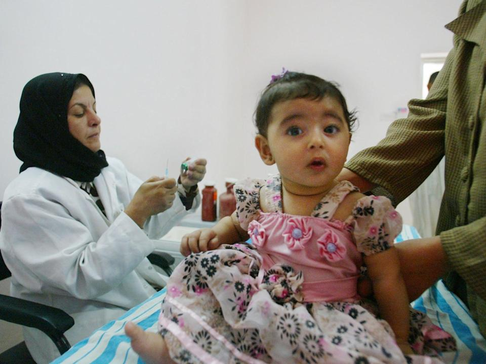 <p>The disease is currently preventable by vaccinating babies</p> (AP Photo/Manish Swarup)