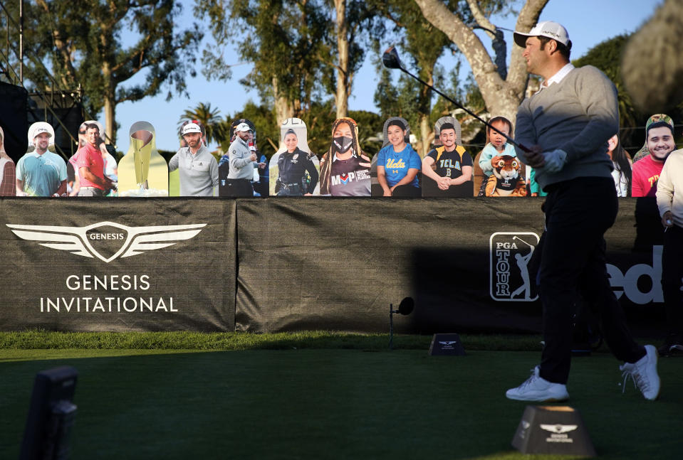 Jon Rahm tees off on the 10th hole in front of cardboard cutout fans during the first round of the Genesis Invitational golf tournament at Riviera Country Club, Thursday, Feb. 18, 2021, in the Pacific Palisades area of Los Angeles. (AP Photo/Ryan Kang)