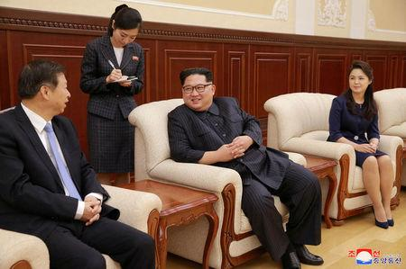 North Korean leader Kim Jong Un and his wife Ri Sol Ju meet with Song Tao, head of the International Department of Communist Party of China (CPC) Central Committee, in this undated photo released by North Korea's Korean Central News Agency (KCNA) in Pyongyang April 17, 2018. KCNA/via Reuters