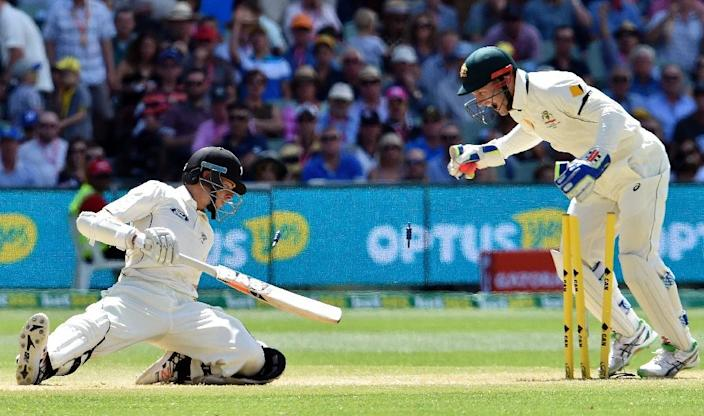 New Zealand batsman Mitchell Santner (L) is stumped out by Australian wicketkeeper Peter Nevill off spin bowler Nathan Lyon during the third day of the day-night Test at the Adelaide Oval on November 29, 2015 (AFP Photo/Saeed Khan)