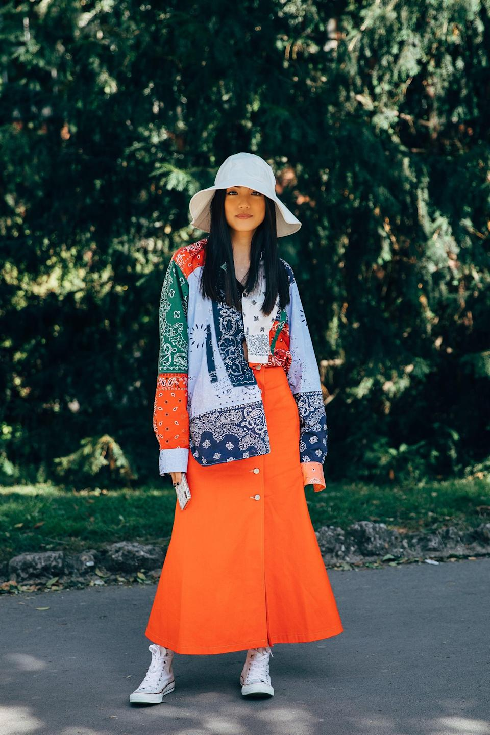 <p>There's nothing we don't love about bold summer colors and a dress paired with sneakers.</p>