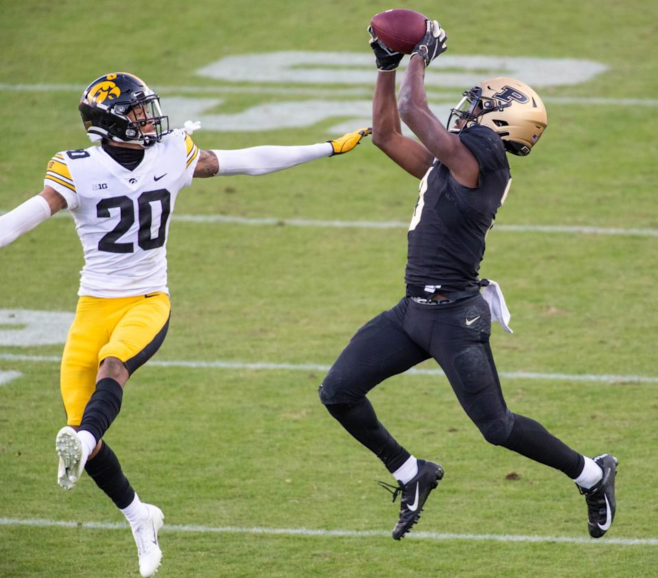 Purdue wide receiver David Bell catches the ball while Iowa defensive back Julius Brents (20) defends in the second half at Ross-Ade Stadium.