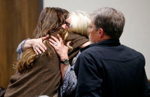 Taya Kyle, left, wife of slain Navy SEAL Chris Kyle, hugs family members as they arrive at the Erath County Donald R. Jones Justice Center, Wednesday, Feb. 11, 2015, in Stephenville, Texas, for the opening day of the capital murder trial of former Marine Cpl. Eddie Ray Routh. Routh, 27, of Lancaster, Texas, is charged with the 2013 deaths of Kyle and his friend Chad Littlefield at a shooting range near Glen Rose, Texas.(AP Photo/The Dallas Morning News, Tom Fox, Pool)