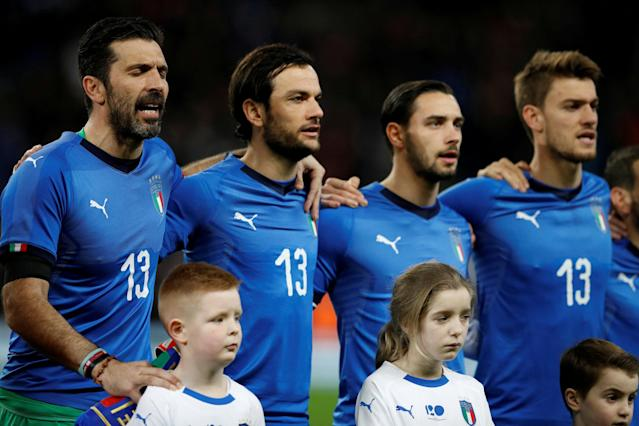Soccer Football - International Friendly - Italy vs Argentina - Etihad Stadium, Manchester, Britain - March 23, 2018 Italy players line up during the national anthem wearing shirts in memory of Davide Astori REUTERS/Phil Noble TPX IMAGES OF THE DAY