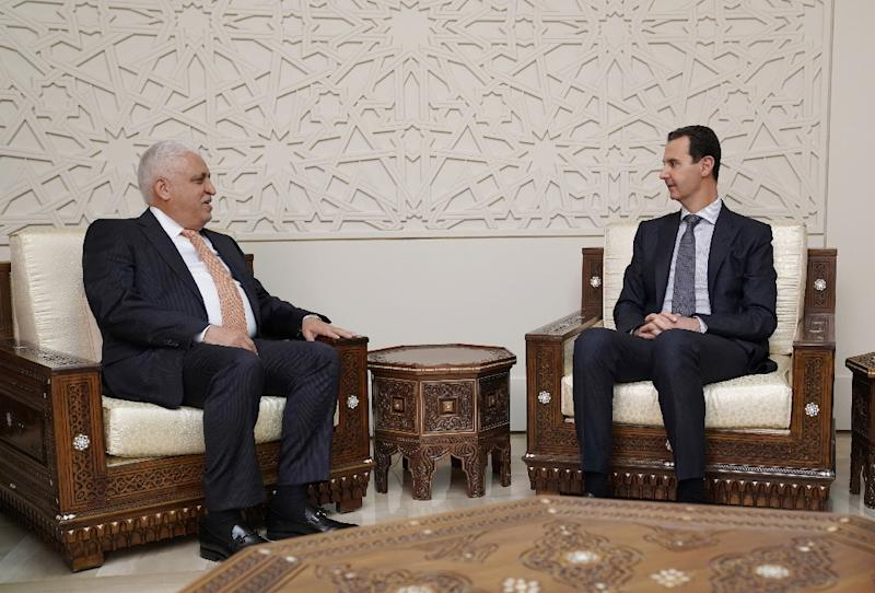 A handout picture released by the official Syrian Arab News Agency (SANA) on December 29, 2018 shows President Bashar al-Assad (R) meeting with Iraqi national security advisor Faleh al-Fayad in the Syrian capital Damascus (AFP Photo/-)