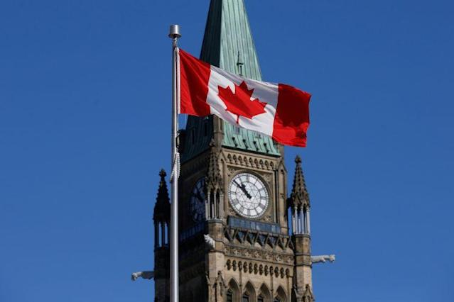A Canadian flag flies in front of the Peace Tower on Parliament Hill in Ottawa, Ont., on March 22, 2017. (Reuters)