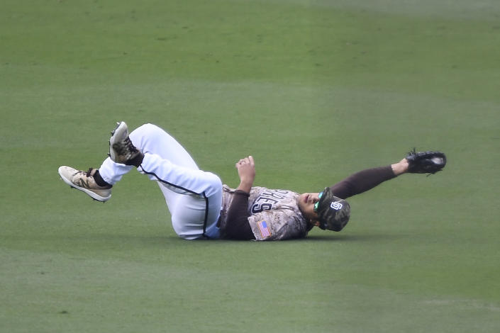San Diego Padres center fielder Trent Grisham (2) makes a diving catch on a ball hit by St. Louis Cardinals' Harrison Bader (48) during the first inning of a baseball game Sunday, May 16, 2021, in San Diego. (AP Photo/Denis Poroy)
