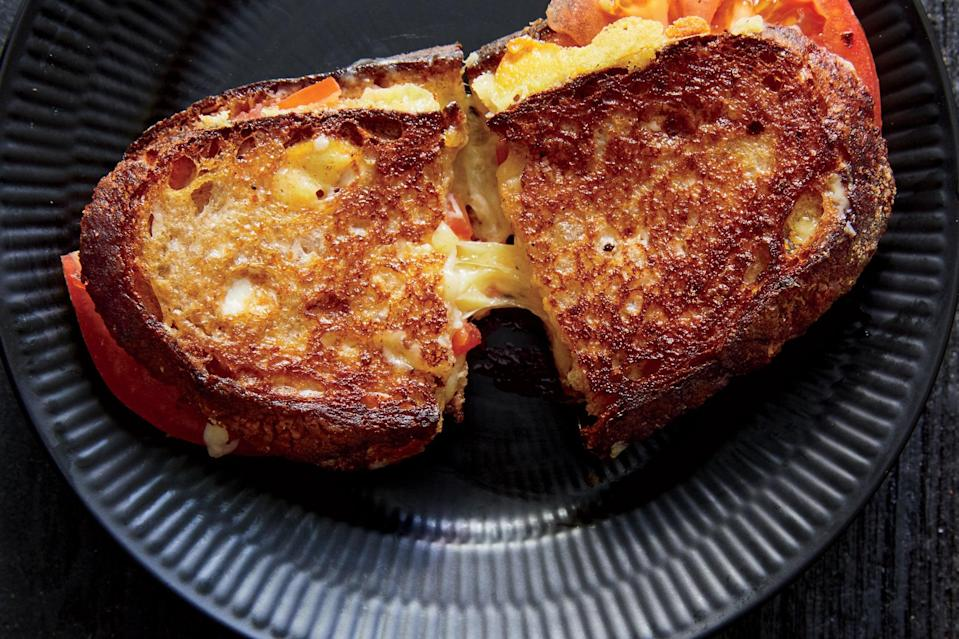 """There's nothing wrong with a plain and simple tomato sandwich, but this <a href=""""https://www.epicurious.com/recipes-menus/13-reasons-to-grill-your-sandwich-gallery?mbid=synd_yahoo_rss"""" rel=""""nofollow noopener"""" target=""""_blank"""" data-ylk=""""slk:grilled cheese"""" class=""""link rapid-noclick-resp"""">grilled cheese</a> really might be the ultimate option. <a href=""""https://www.epicurious.com/recipes/food/views/grilled-cheese-sandwich-with-tomatoes?mbid=synd_yahoo_rss"""" rel=""""nofollow noopener"""" target=""""_blank"""" data-ylk=""""slk:See recipe."""" class=""""link rapid-noclick-resp"""">See recipe.</a>"""
