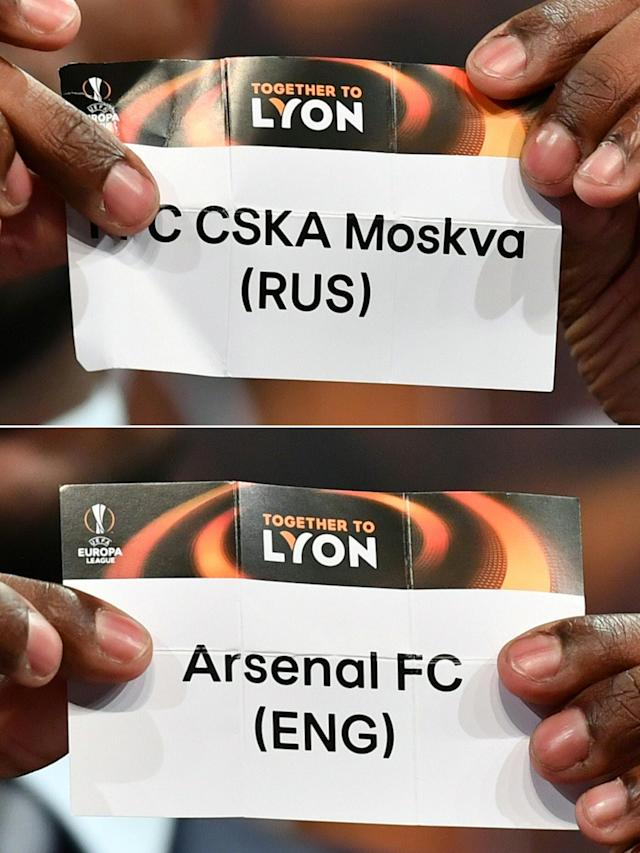 Eric Abidal showing the slip of PFC CSKA Moskva and Arsenal FC during the draw for the quarter finals