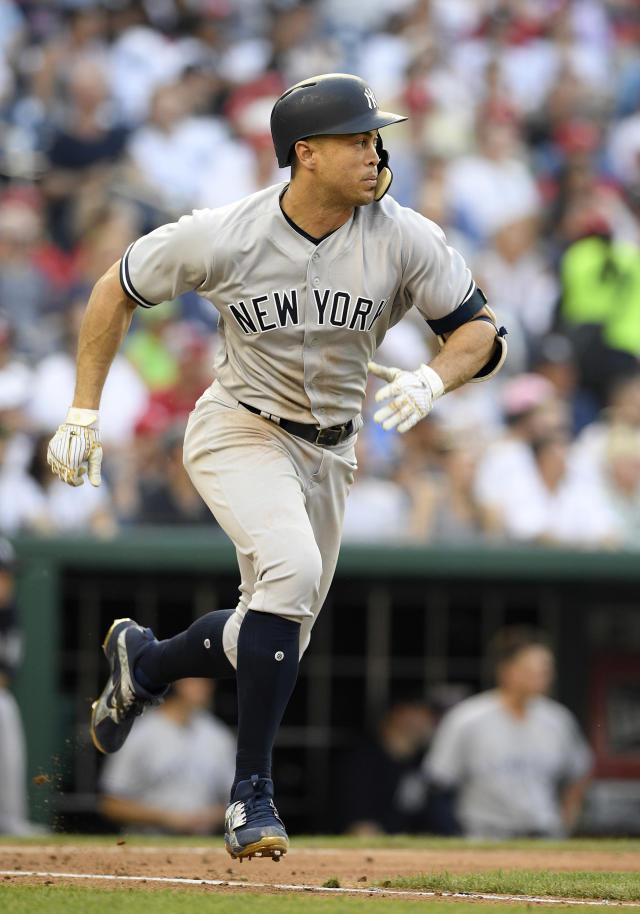 New York Yankees' Giancarlo Stanton runs to first on his single during the fourth inning of a baseball game against the Washington Nationals, Monday, June 18, 2018, in Washington. (AP Photo/Nick Wass)