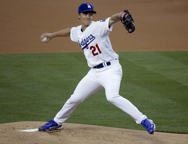 fLos Angeles Dodgers starting pitcher Zack Greinke throws to an Arizona Diamondbacks batter during first inning of a baseball in Los Angeles, Friday, April 18, 2014. (AP Photo/Chris Carlson)
