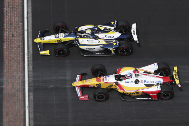 Charlie Kimball, top, and Takuma Sato, of Japan, cross the start/finish line during the final practice session for the Indianapolis 500 IndyCar auto race at Indianapolis Motor Speedway, Friday, May 24, 2019, in Indianapolis. (AP Photo/Michael Conroy)