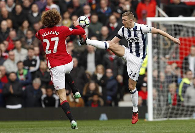 <p>Manchester United's Marouane Fellaini, left, and West Bromwich Albion's Darren Fletcher during the English Premier League soccer match at Old Trafford in Manchester, England </p>