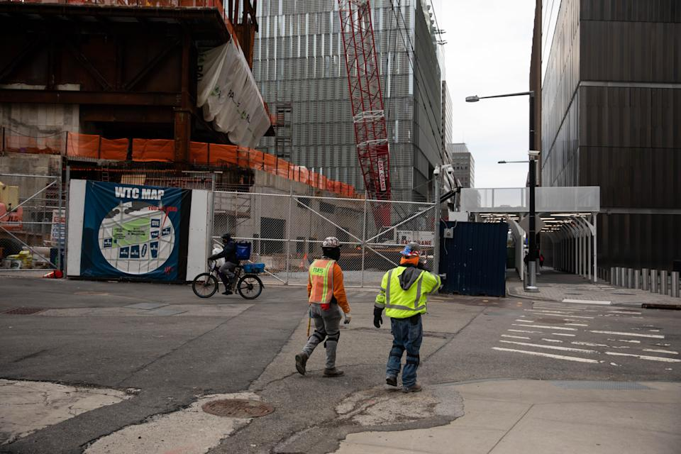 NEW YORK, Jan. 8, 2021 -- Construction workers walk in front of the Ronald O. Perelman Performing Arts Center at the World Trade Center construction site, in New York, United States, Jan. 8, 2021. U.S. employers slashed 140,000 jobs in December, the first monthly decline since April 2020, as the recent COVID-19 spikes disrupted labor market recovery, the Labor Department reported Friday.  The unemployment rate, which has been trending down over the past seven months, remained unchanged at 6.7 percent, according to the monthly employment report. (Photo by Michael Nagle/Xinhua via Getty) (Xinhua/Michael Nagle via Getty Images)