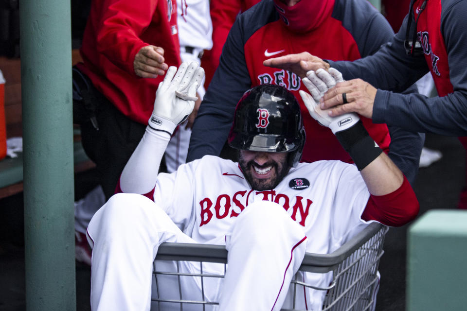 BOSTON, MA - APRIL 19: J.D. Martinez #28 of the Boston Red Sox reacts as he is pushed in a laundry cart after hitting a solo home during the second inning of a game against the Chicago White Sox on April 19, 2021 at Fenway Park in Boston, Massachusetts. (Photo by Billie Weiss/Boston Red Sox/Getty Images)