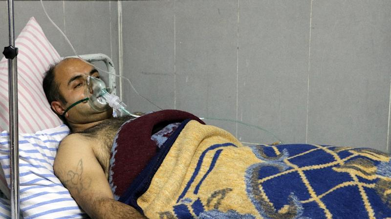 Six men were treated for breathing difficulties in the Afrin hospital after shelling by a Turkish-led offensive on their village, the head of the hospital said (AFP Photo/Ahmad Shafie BILAL)