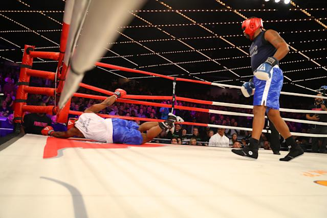 <p>Kevon Sample (blue) knocks down Larry Carson (red) in the LT Rumble Match at the NYPD Boxing Championships at Madison Square Garden's Hulu Theater on March 15, 2018. (Gordon Donovan/Yahoo News) </p>