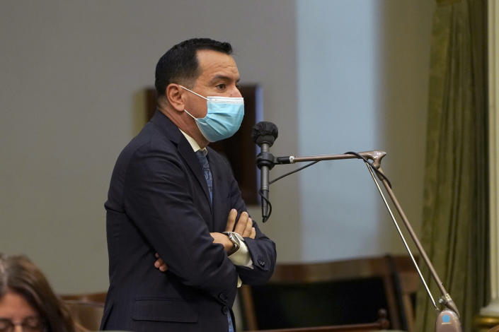 FILE - In this July 15, 2021, file photo, Assembly Speaker Anthony Rendon, D-Lakewood, wears a face mask as he addresses the Assembly in Sacramento, Calif. On Monday, Aug. 16, 2021, Rendon said all Assembly employees must be vaccinated against the coronavirus and must have begun the vaccination process by Sept. 1. Rendon said the move will protect everyone who enters the Capitol. (AP Photo/Rich Pedroncelli, File)
