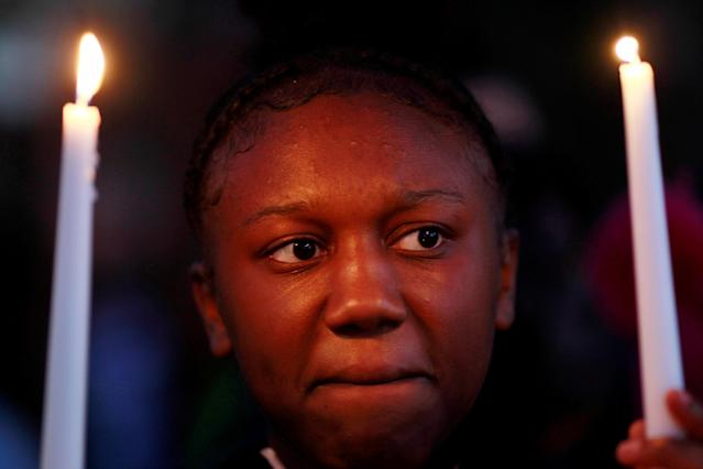 Deonnah Conway holds candles during a protest over the police shooting of Stephon Clark, in Sacramento, California, U.S. March 23, 2018. REUTERS/Bob Strong TPX IMAGES OF THE DAY