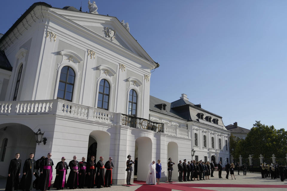 Pope Francis, white figure at center bottom, flanked by Slovakian President Zuzana Caputova, attends a welcoming ceremony at the presidential palace in Bratislava, Slovakia, Monday, Sept. 13, 2021. Francis is on a four-day visit to Central Europe, in Hungary and Slovakia, in his first big international outing since undergoing intestinal surgery in July. (AP Photo/Gregorio Borgia)