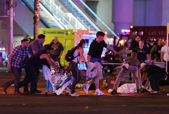 <p>An injured person is tended to in the intersection of Tropicana Ave. and Las Vegas Boulevard after a mass shooting at a country music festival nearby on Oct. 2, 2017 in Las Vegas, Nevada. (Photo: David Becker/Getty Images) </p>