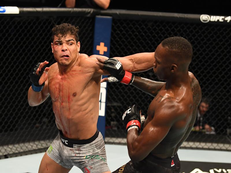 Israel Adesanya (right) retained his middleweight title by finishing Paulo Costa (Zuffa LLC)