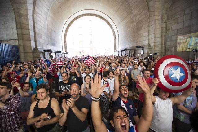 U.S. soccer fans cheer at the start of the team's 2014 World Cup Group G soccer match against Germany at a viewing party under the Manhattan Bridge in New York June 26, 2014. REUTERS/Lucas Jackson (UNITED STATES - Tags: SPORT SOCCER WORLD CUP)