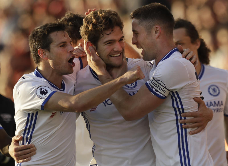 Chelsea's Marcos Alonso, centre celebrates with his teammates after scoring his sides 3rd goal during their English Premier League soccer match between Bournemouth and Chelsea at Dean Court stadium in Bournemouth, England, Saturday, April 8, 2017. (AP Photo/Matt Dunham)