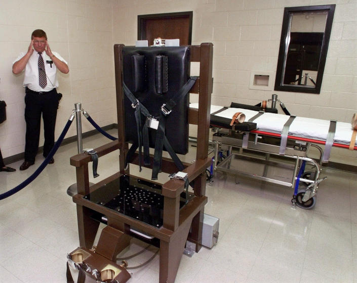 FILE - In this Oct. 13, 1999, file photo, Ricky Bell, then the warden at Riverbend Maximum Security Institution in Nashville, Tenn., gives a tour of the prison's execution chamber. Three condemned inmates in Tennessee have chosen to die in the electric chair in the past year, claiming the state's lethal injection method is even worse. The inmates argued in court that the midazolam-based lethal injection method causes feelings of burning and suffocating. Tennessee has three executions scheduled, and nine more in the works. Unless something changes, it is likely the three inmates who opted for the electric chair won't be the last. (AP Photo/Mark Humphrey, File)