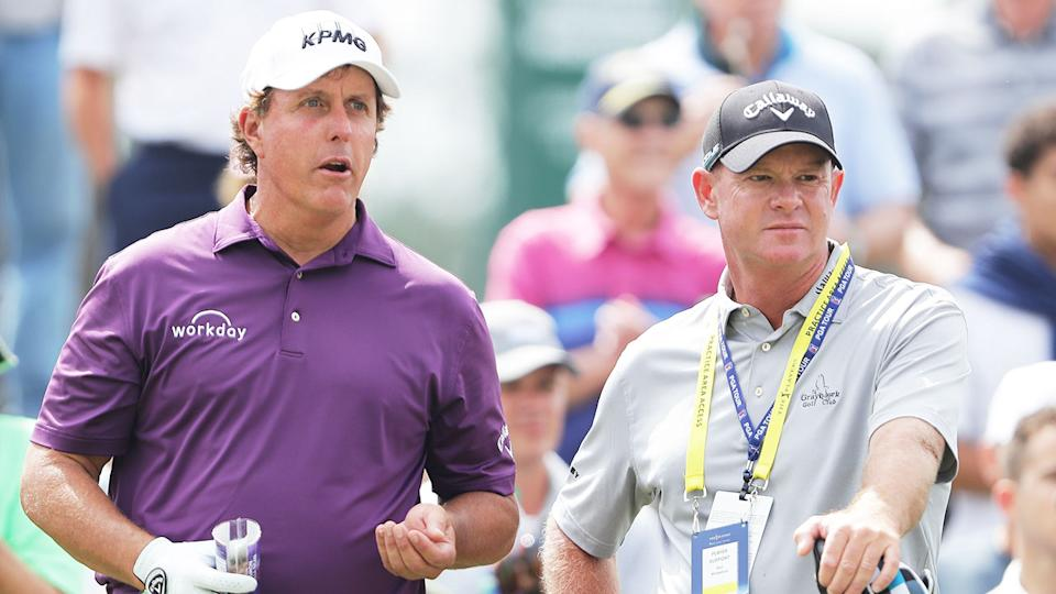 Seen here, Phil Mickelson and his Aussie coach Andrew Getson stand together on the course.