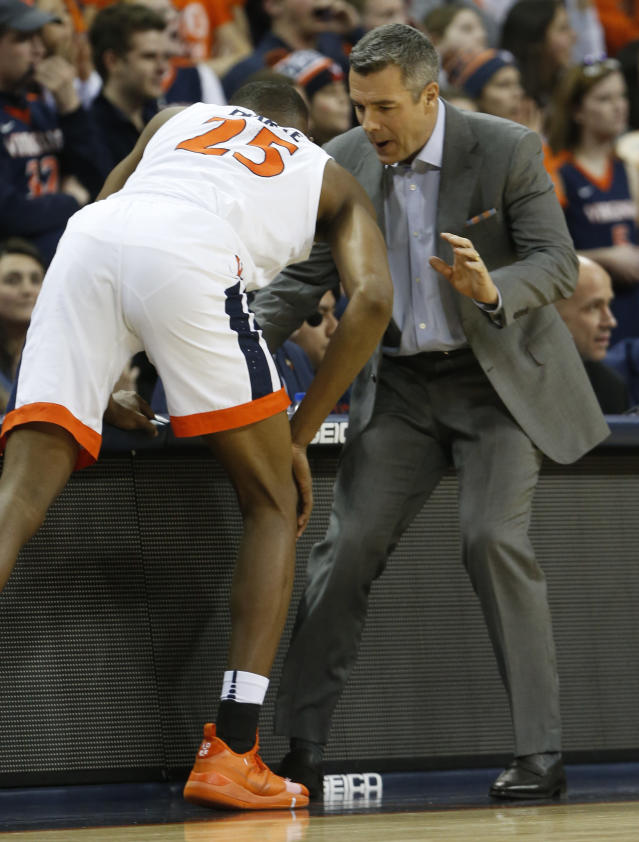 Virginia head coach Tony Bennett instructs Virginia forward Mamadi Diakite (25) during the first half of an NCAA college basketball game against Virginia Tech, in Charlottesville, Va., Tuesday, Jan. 15, 2019. (AP Photo/Steve Helber)