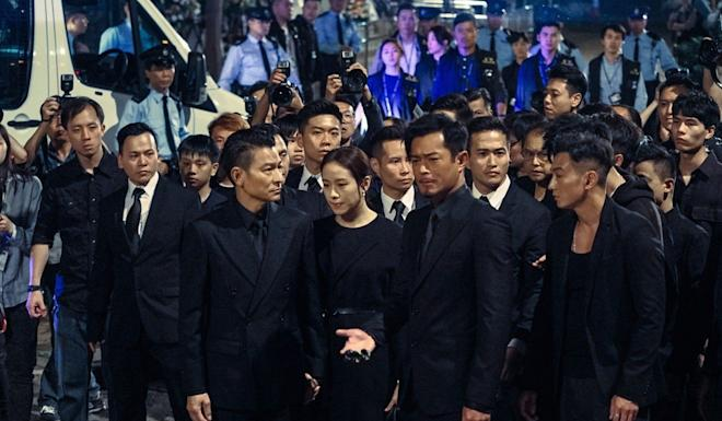 A scene showing stars Andy Lau (centre left) and Louis Koo (right) in The White Storm 2. Photo: Handout