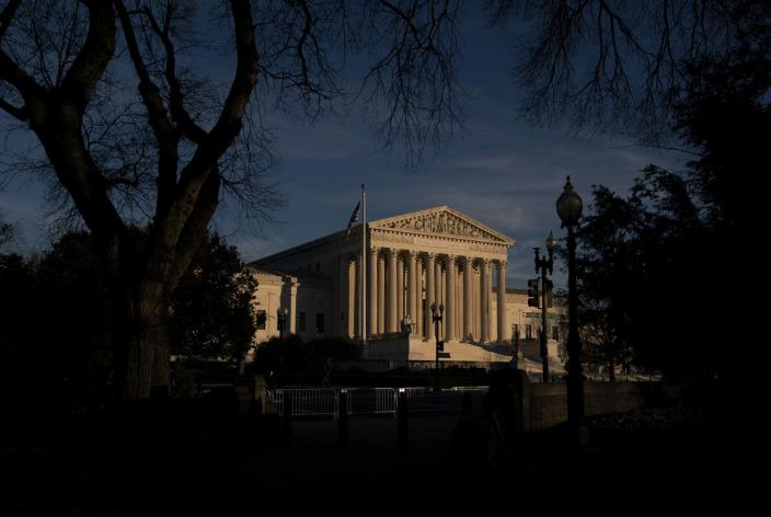 """<span class=""""caption"""">Political pressure is focusing on the makeup of the U.S. Supreme Court.</span> <span class=""""attribution""""><a class=""""link rapid-noclick-resp"""" href=""""https://www.gettyimages.com/detail/news-photo/the-u-s-supreme-court-stands-on-december-11-2020-in-news-photo/1230073841"""" rel=""""nofollow noopener"""" target=""""_blank"""" data-ylk=""""slk:Stefani Reynolds/Getty Images"""">Stefani Reynolds/Getty Images</a></span>"""