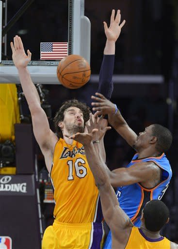 Oklahoma City Thunder forward Kevin Durant, right, puts up a shot as Los Angeles Lakers forward Pau Gasol, of Spain, defends during the first half in Game 4 of an NBA basketball playoffs Western Conference semifinal, Saturday, May 19, 2012, in Los Angeles. (AP Photo/Mark J. Terrill)