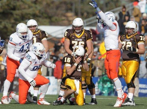 Boise State defender Demarcus Lawrence (8) celebrates after sacking Wyoming quarterback Brett Smith during the second quarter of an NCAA college football game Saturday, Oct. 27, 2012, in Laramie, Wyo. Boise State won 45-14. (AP Photo/Michael Smith)