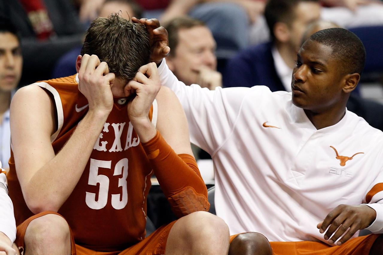 NASHVILLE, TN - MARCH 16:  Clint Chapman (L) #53 of the Texas Longhorns hides his head in his jersey on the bench against the Cincinnati Bearcats during the second round of the 2012 NCAA Men's Basketball Tournament at Bridgestone Arena on March 16, 2012 in Nashville, Tennessee.  (Photo by Kevin C. Cox/Getty Images)