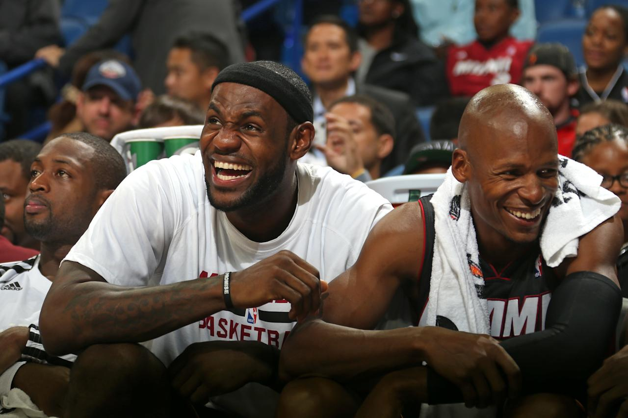 NEW ORLEANS, LA - OCTOBER 23:  LeBron James #6 and Ray Allen #34 of the Miami Heat laugh against the New Orleans Pelicans during an NBA preseason game on April 14, 2013 at the New Orleans Arena in New Orleans, Louisiana. NOTE TO USER: User expressly acknowledges and agrees that, by downloading and or using this Photograph, user is consenting to the terms and conditions of the Getty Images License Agreement. Mandatory Copyright Notice: Copyright 2013 NBAE (Photo by Layne Murdoch/NBAE via Getty Images)