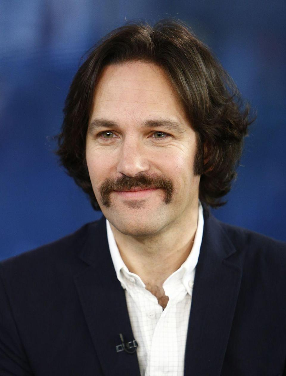 <p>Going for a full retro 70s look, Paul Rudd pulls of a full handlebar mustache, proving that classic cool never goes out of style. </p>