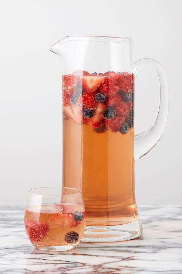"""<p>A crisper, totally refreshing alternative to classic red sangria.</p><p>Get the recipe from <a href=""""https://www.delish.com/cooking/recipes/a43032/best-berry-sangria-recipe/"""" rel=""""nofollow noopener"""" target=""""_blank"""" data-ylk=""""slk:Delish"""" class=""""link rapid-noclick-resp"""">Delish</a>.</p>"""