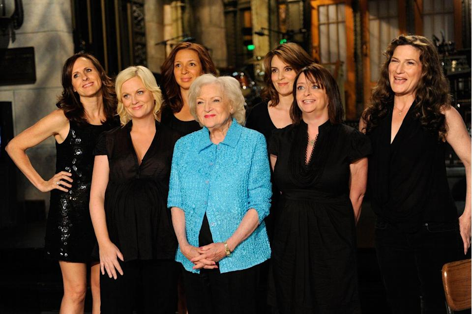 """<p>After appearing in a 2010 Super Bowl commercial for Snickers, Betty surged in popularity. Soon an internet campaign was launched to have the comedic actress host <em>Saturday Night Live</em>. She did so in 2010 and at the age of 88 she became the <a href=""""https://www.insider.com/betty-white-facts-career-2019-1"""" rel=""""nofollow noopener"""" target=""""_blank"""" data-ylk=""""slk:oldest celebrity to host"""" class=""""link rapid-noclick-resp"""">oldest celebrity to host</a> the show. </p>"""