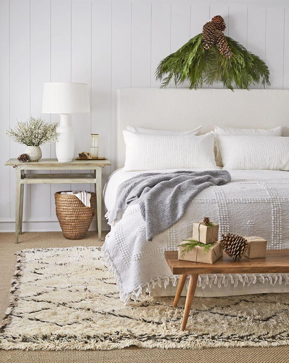 "<p>You don't need slippers when there's a super-soft carpet underfoot. Keep extra throw blankets in a woven basket by the bed for even more cozy texture. </p><p><a class=""link rapid-noclick-resp"" href=""https://go.redirectingat.com?id=74968X1596630&url=https%3A%2F%2Fwww.wayfair.com%2Frugs%2Fpdp%2Frundell-shag-ivory-area-rug-lfmf2267.html%3Fpiid%3D23395383&sref=https%3A%2F%2Fwww.goodhousekeeping.com%2Fhome%2Fdecorating-ideas%2Fg770%2Fdecor-ideas-master-bedroom%2F"" rel=""nofollow noopener"" target=""_blank"" data-ylk=""slk:SHOP RUGS"">SHOP RUGS</a></p>"