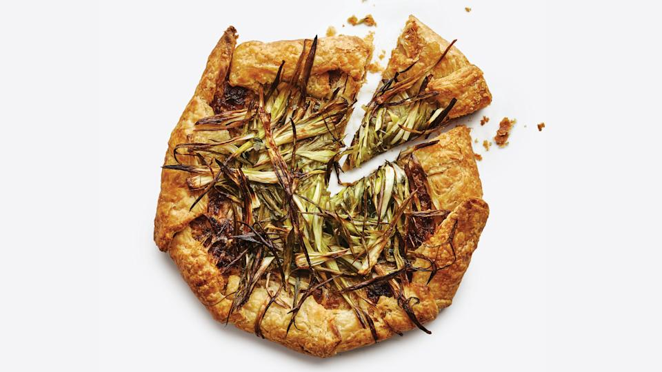 """Pies aren't just for dessert. The ninth recipe in the <a href=""""https://www.bonappetit.com/collection/the-basically-guide-to-better-baking?mbid=synd_yahoo_rss"""" rel=""""nofollow noopener"""" target=""""_blank"""" data-ylk=""""slk:Basically Guide to Better Baking"""" class=""""link rapid-noclick-resp""""><strong>Basically Guide to Better Baking</strong></a> is a free-form tart that combines three alliums (scallions, garlic, and onion) for maximum flavor and crispy-jammy texture. And we'd happily eat it for breakfast, lunch, or dinner. The key to the flaky crust is to move fast! Rolling and folding the dough while the butter is still cold creates distinct layers of butter and flour that will steam apart during baking, making the crust light and flaky. Got questions? Head to <a href=""""https://basicallybaking.bonappetit.com/?_ga=2.48508065.64475321.1585748604-609482512.1585748604"""" rel=""""nofollow noopener"""" target=""""_blank"""" data-ylk=""""slk:our forum"""" class=""""link rapid-noclick-resp""""><strong>our forum</strong></a> and we'll try to help. <a href=""""https://www.bonappetit.com/recipe/triple-threat-onion-galette?mbid=synd_yahoo_rss"""" rel=""""nofollow noopener"""" target=""""_blank"""" data-ylk=""""slk:See recipe."""" class=""""link rapid-noclick-resp"""">See recipe.</a>"""