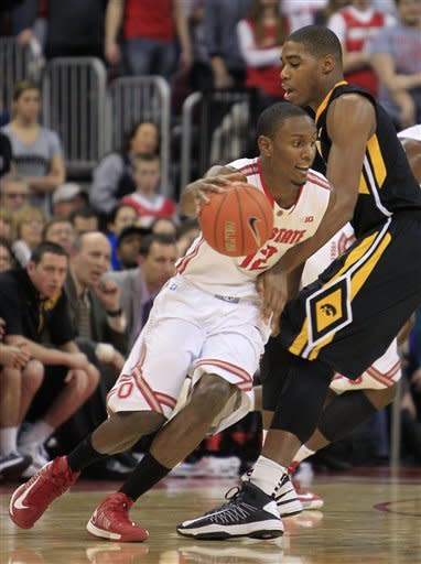Ohio State's Sam Thompson, left, drives around Iowa's Melsahn Basabe during the first half of an NCAA college basketball game Tuesday, Jan. 22, 2013, in Columbus, Ohio. (AP Photo/Jay LaPrete)