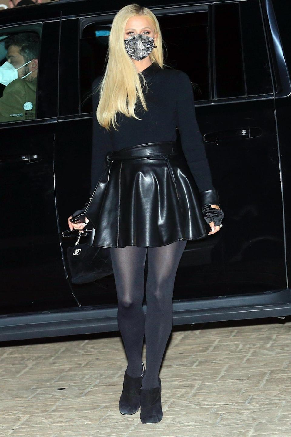 <p>Paris Hilton dresses in all black as she steps out on a date night with fiancé Carter Reum in Malibu on Tuesday.</p>